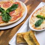 Pizza y Lasagna al horno de piedra en CIRCO Cali